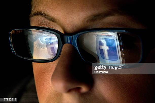 In this file photo the Facebook Inc logo is reflected in the eyeglasses of a user in this arranged photo in San Francisco California US on Wednesday...