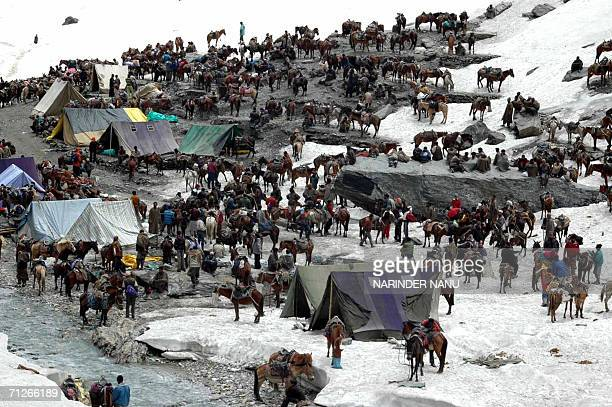 In this file photograph dated 09 June 2006 Hindu pilgrims set up camp their way to the the holy cave of Amarnath situated at a height of 3800 meters...