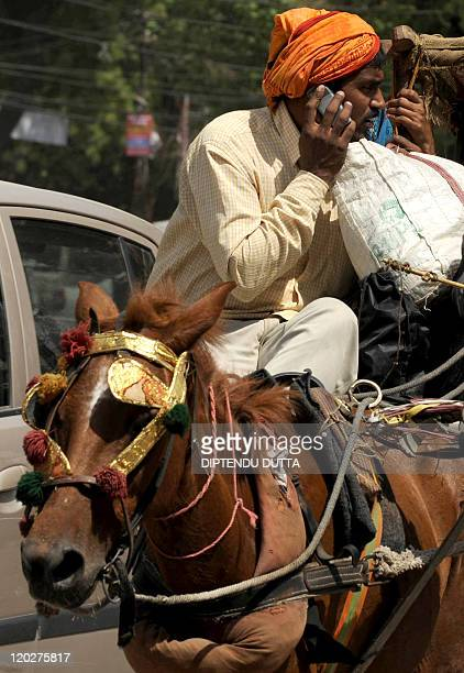 In this file photograph taken on April 10 2010 an Indian traveller speaks on a cellullar telephone in Allahabad When British mobile phone giant...