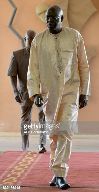 In this file photograph taken on January 18 then President of the National Assembly Salifou Diallo walks at the airport in Ouagadougou According to...