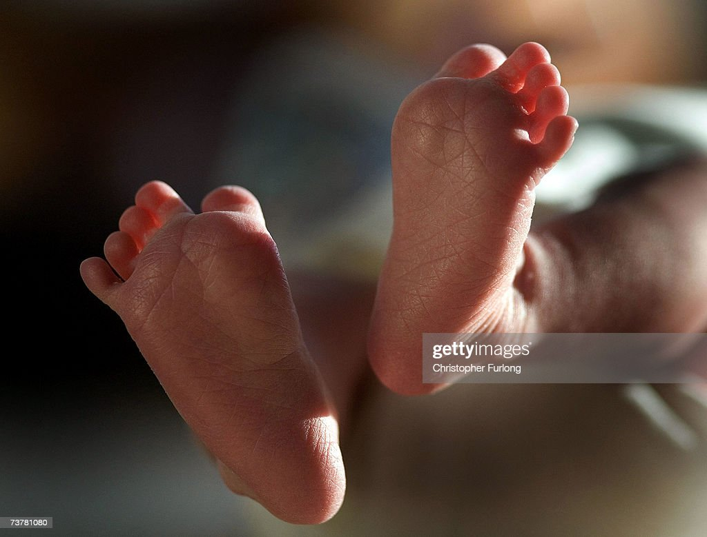 In this file photograph taken on March 20 a twoweekold boy finds his feet in his new world Health Secretary Patricia Hewitt announced April 3 2007...