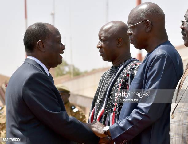 In this file photograph taken on March 4 then president of the National Assembly of Burkina Faso and leader of the ruling party Salifou Diallo shakes...