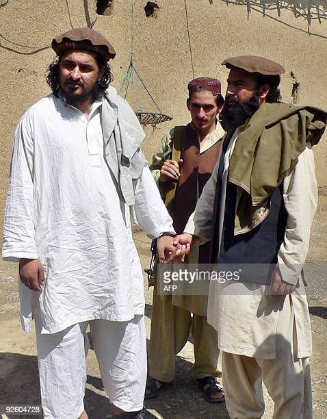 In this file photograph taken on October 4 Pakistani Taliban chief Hakimullah Mehsud arrives with his commander Waliur Rehman for his meeting with...