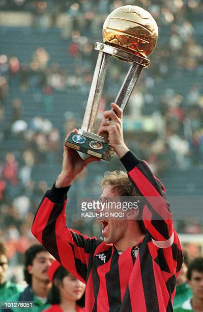 REPEAT In this file picture dated December 17 AC Milan captain and defender Franco Baresi celebrates as he holds the trophy aloft after his team beat...
