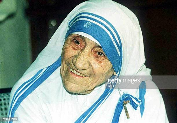 In this file picture taken 12 April 1995 Mother Teresa smiles as she poses for photographers in Calcutta Mother Teresa will be beatified 19 October...