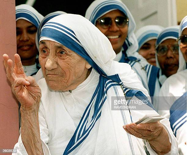In this file picture taken 15 May 1997 Mother Teresa stands with nuns of the Missionaries of Charity For Destitute Children in New Delhi Mother...