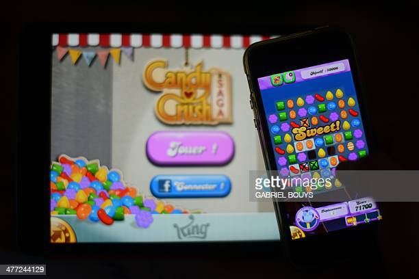 In this file picture taken on January 25 2014 a man plays at Candy Crush Saga on his Iphone in Rome Candy Crush is one of the top online games...