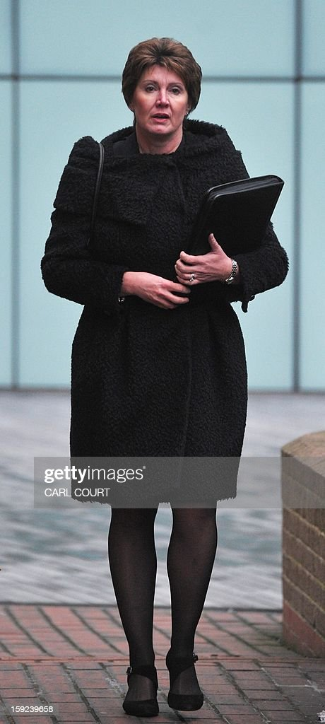 In this file picture taken on January 7, 2013 Detective April Casburn arrives at Southwark Crown Court in central London, to face charges related to misconduct in a public office over claims she passed information to the News of the World, the now-defunct tabloid. A former British counter-terrorism detective was found guilty on January 10, 2013 of trying to sell information about a phone hacking investigation to the Rupert Murdoch-owned News of the World tabloid. A jury convicted Detective Chief Inspector April Casburn of offering the now-defunct newspaper information about a probe into whether Scotland Yard's inquiry into the illegal hacking of mobile phones should be reopened. AFP PHOTO/CARL COURT