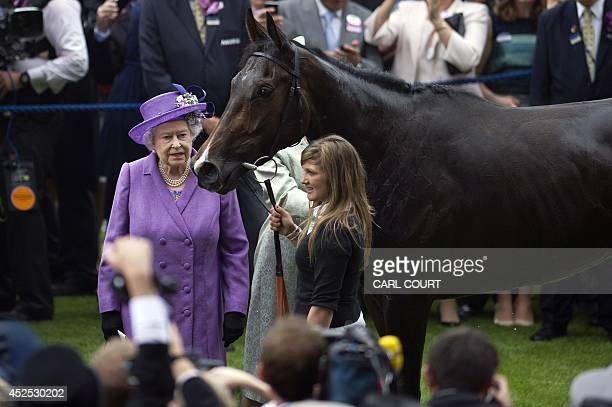 In this file picture taken on June 20 2013 Britain's Queen Elizabeth II stands beside her horse Estimate in the winner's enclosure after it won the...