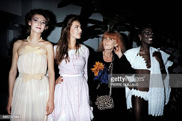In this file picture taken on June 24 1982 shows Sonia Rykiel director of the 'ESMOD' school of fashion surrounded by her pupils presenting their own...