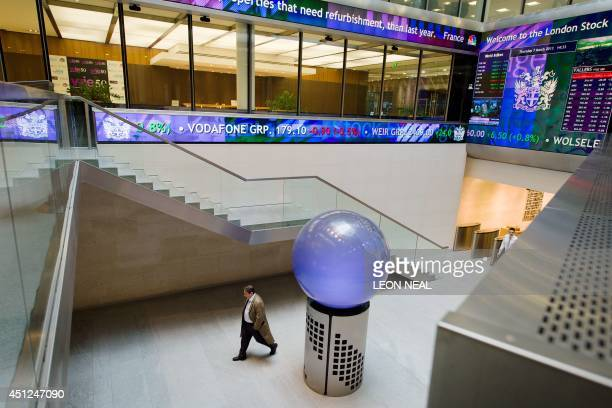 In this file picture taken on March 7 2013 people walk in the foyer of the London Stock Exchange in central London London Stock Exchange Group has...