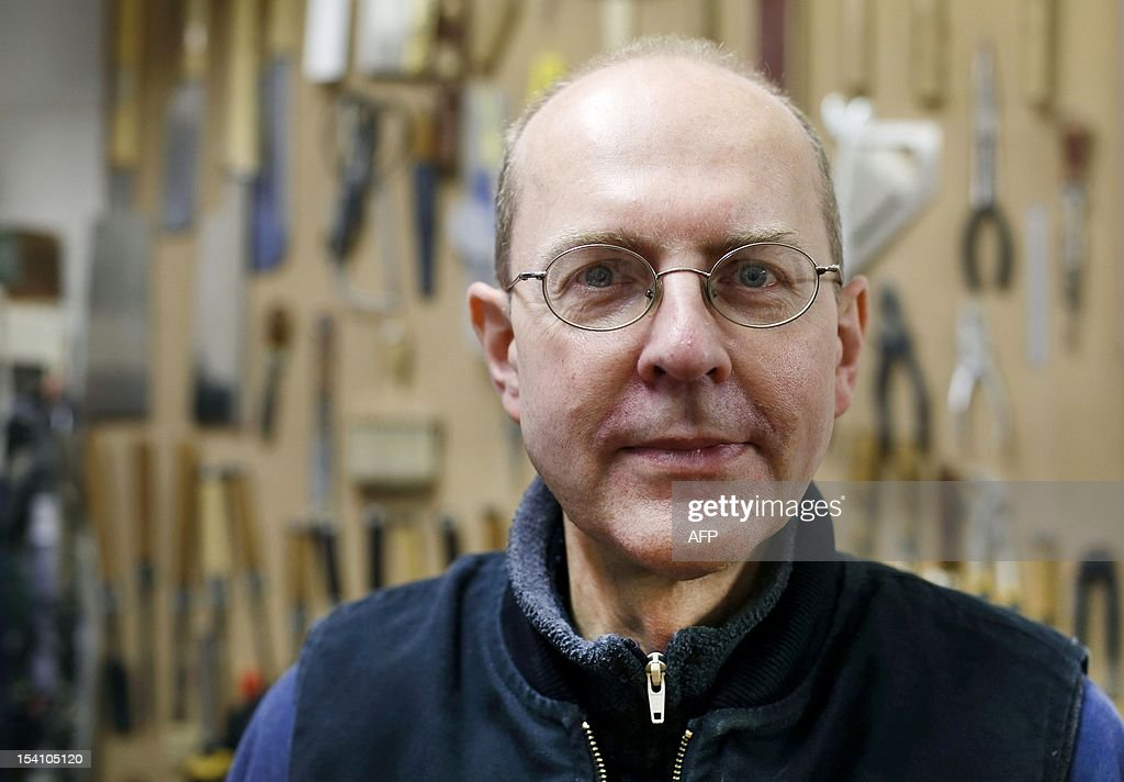 In this file picture taken on October 8, 2012 Canadian-born furniture-maker Michael Ibsen, a direct descendant of the eldest sister of meieval British King Richard III, poses in his furniture workshop in London. An archaeological thriller has ignited a passion for history in Britain, where ongoing DNA tests on samples taken from a Canadian born carpenter and a skeleton unearthed from the foundations of a carpark in the city of Leicester, are being carried out to determine whether or not the skeleton is that of Medieval King Richard III. AFP PHOTO/JUSTIN TALLIS - TO GO WITH STORY BY DENIS HIAULT