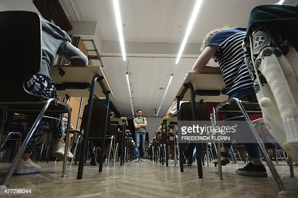 In this file picture takenon June 16 2014 French students work on the test of philosophy as they take the baccalaureat exam at the Fustel de...