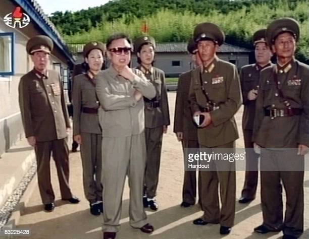In this frame grab made off undated North Korea's Korean Central Television footage aired on October 11 2008 North Korean leader Kim Jong Il claps as...