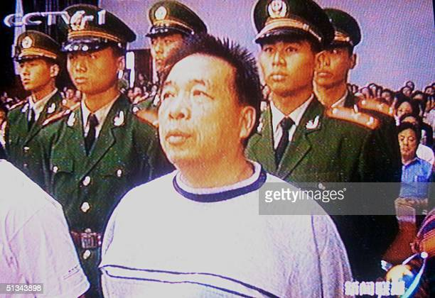 In this frame taken off China's state television an official arrested on corruption charges stands at attention in a Chinese court of law 08 November...