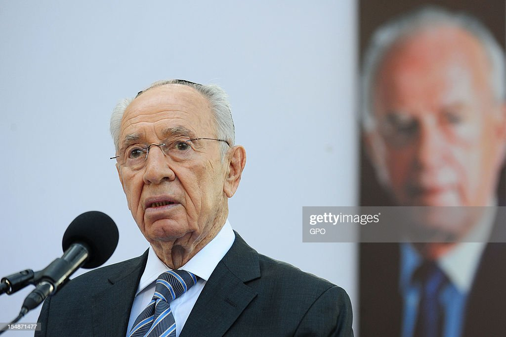 In this GPO handout, Israeli President <a gi-track='captionPersonalityLinkClicked' href=/galleries/search?phrase=Shimon+Peres&family=editorial&specificpeople=201775 ng-click='$event.stopPropagation()'>Shimon Peres</a> speaks at the grave of Israeli Prime Minister Yitzhak Rabin during a memorial ceremony marking the 17th anniversary of the assassination of Israeli Prime Minister Yitzhak Rabin, October 28, 2012 in Jerusalem, Israel. Rabin who won the Nobel Peace Prize with <a gi-track='captionPersonalityLinkClicked' href=/galleries/search?phrase=Shimon+Peres&family=editorial&specificpeople=201775 ng-click='$event.stopPropagation()'>Shimon Peres</a> and Yasser Arafat, was assassinated by right-wing Israeli radical Yigal Amir.
