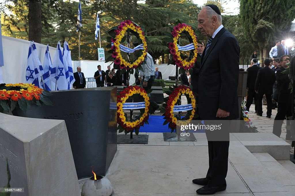 In this GPO handout, Israeli President <a gi-track='captionPersonalityLinkClicked' href=/galleries/search?phrase=Shimon+Peres&family=editorial&specificpeople=201775 ng-click='$event.stopPropagation()'>Shimon Peres</a> stands by the grave of Israeli Prime Minister Yitzhak Rabin during a memorial ceremony marking the 17th anniversary of the assassination of Israeli Prime Minister Yitzhak Rabin, October 28, 2012 in Jerusalem, Israel. Rabin who won the Nobel Peace Prize with <a gi-track='captionPersonalityLinkClicked' href=/galleries/search?phrase=Shimon+Peres&family=editorial&specificpeople=201775 ng-click='$event.stopPropagation()'>Shimon Peres</a> and Yasser Arafat, was assassinated by right-wing Israeli radical Yigal Amir.