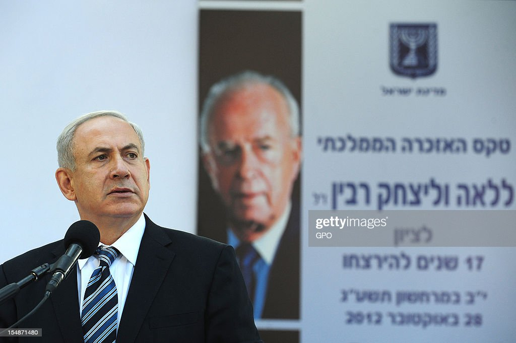 In this GPO handout, Israeli Prime Minister <a gi-track='captionPersonalityLinkClicked' href=/galleries/search?phrase=Benjamin+Netanyahu&family=editorial&specificpeople=118594 ng-click='$event.stopPropagation()'>Benjamin Netanyahu</a> speaks as he stands by the grave of Israeli Prime Minister Yitzhak Rabin during a memorial ceremony marking the 17th anniversary of the assassination of Israeli Prime Minister Yitzhak Rabin, October 28, 2012 in Jerusalem, Israel. Rabin who won the Nobel Peace Prize with Shimon Peres and Yasser Arafat, was assassinated by right-wing Israeli radical Yigal Amir.