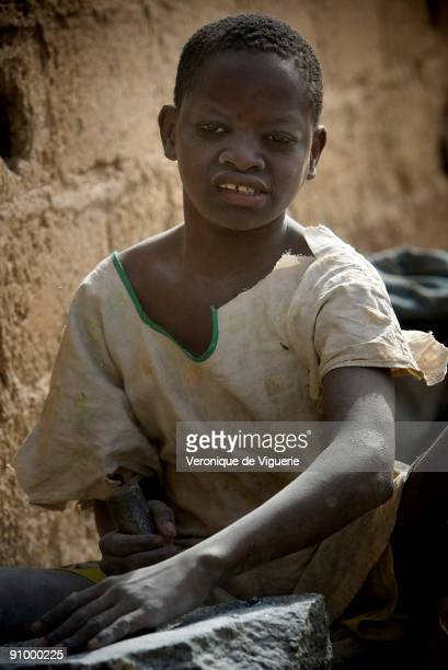 In this gravelpit hundreds of people are working in horrendous conditions and many of them are children Instead of going to school they are working...