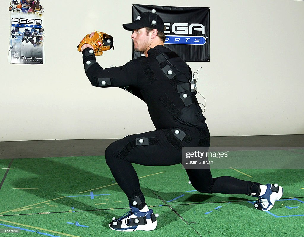 In this handout by Sega Sports New York Yankees first baseman Jason Giambi performs a fielding move during a motion capture session January 21 2003...