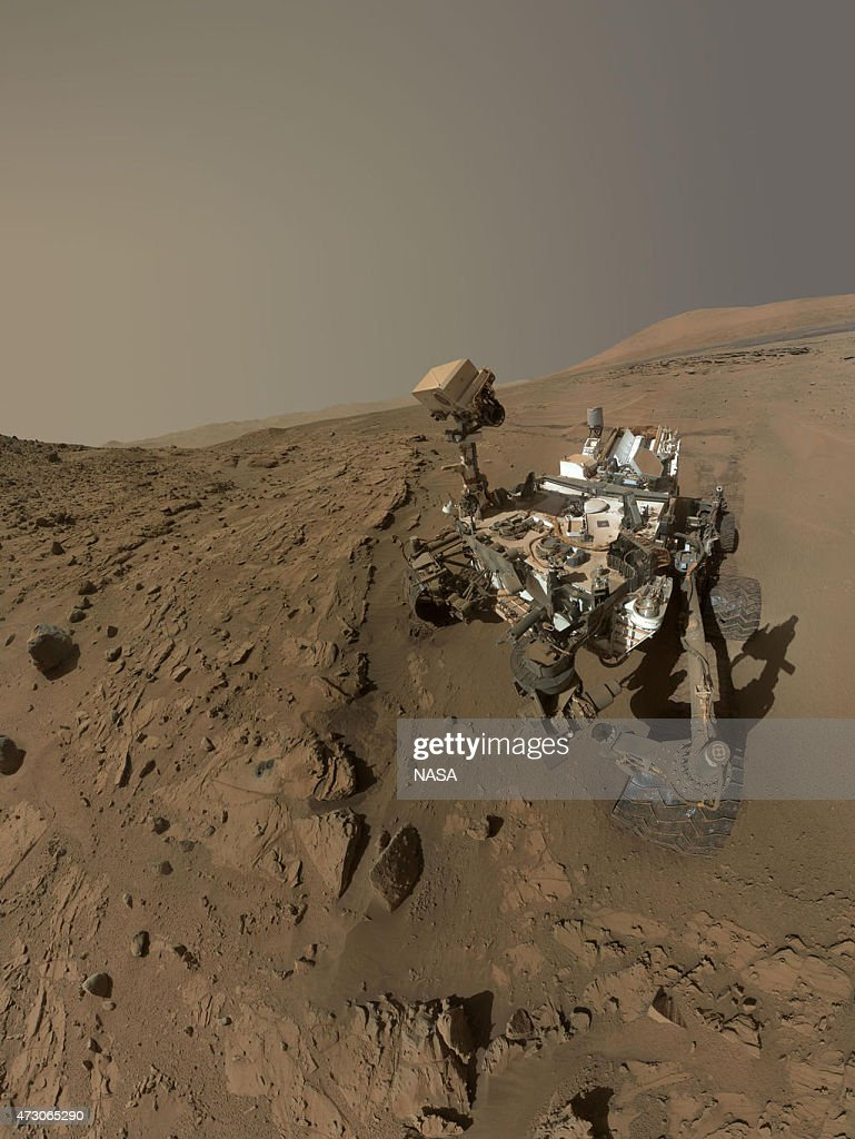 In this handout composite provided by NASA/JPL-Caltech/MSSS NASA's Curiosity Mars rover used the camera at the end of its arm in April and May 2014 to take dozens of component images combined into this self-portrait where the rover drilled into a sandstone target called 'Windjana.' The camera is the Mars Hand Lens Imager (MAHLI), which previously recorded portraits of Curiosity at two other important sites during the mission.