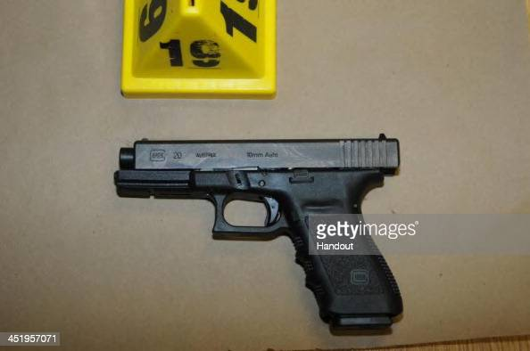In this handout crime scene evidence photo provided by the Connecticut State Police shows a Glock 20 10mm found near the shooter in Room 10 at Sandy...