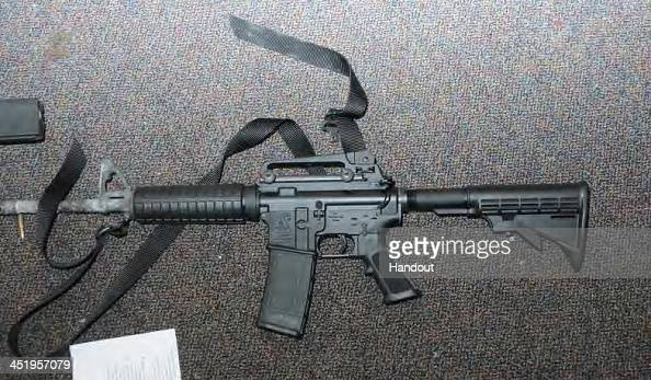 In this handout crime scene evidence photo provided by the Connecticut State Police shows a Bushmaster rifle in Room 10 at Sandy Hook Elementary...