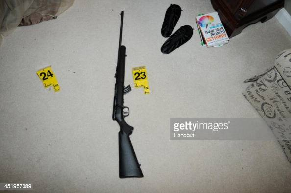 In this handout crime scene evidence photo provided by the Connecticut State Police shows a rifle in the master bedroom in the suspect's house on...