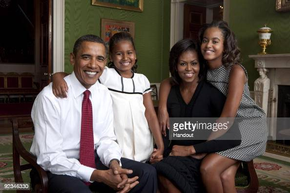 In this handout form the White House US President Barack Obama daughter Malia Obama first lady Michelle Obama and daughter Sasha Obama sit for...