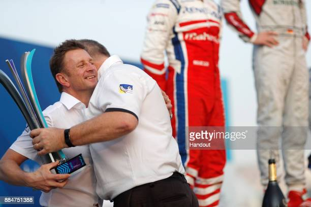 In this handout from FIA Formula E Allan McNish Team Principal Audi Sport Abt Schaeffler accepts the tophy for winning constructor on the podium...