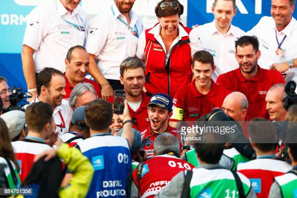 In this handout from FIA Formula E Daniel Abt Audi Sport ABT Schaeffler Audi etron FE04 celebrtes with his team after winning the race during the...