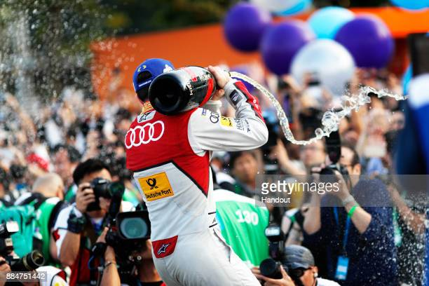 In this handout from FIA Formula E Daniel Abt Audi Sport ABT Schaeffler Audi etron FE04 celebrates on the odum after winning the race during the Hong...