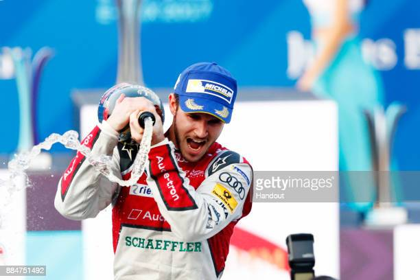 In this handout from FIA Formula E Daniel Abt Audi Sport ABT Schaeffler Audi etron FE04 sprays the chapagne after winning the race during the Hong...