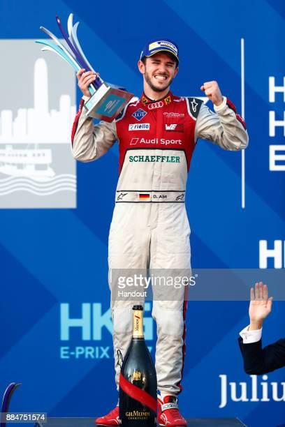 In this handout from FIA Formula E Daniel Abt Audi Sport ABT Schaeffler Audi etron FE04 celebrates with his trophy on the podium during the Hong Kong...