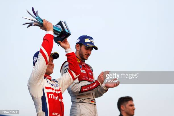 In this handout from FIA Formula E Felix Rosenqvist Mahindra Racing Mahindra M4Electro and Daniel Abt Audi Sport ABT Schaeffler Audi etron FE04...