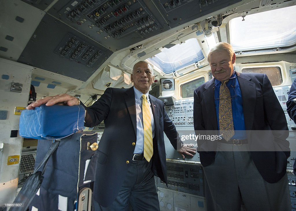 In this handout from NASA, Administrator Charles Bolden of NASA (L) is seen with former NASA astronaut John Creighton in the Space Shuttle Trainer Crew Compartment in the Charles Simonyi Space Gallery while on a tour at the Museum of Flight on January 15, 2013 in Seattle, Washington.