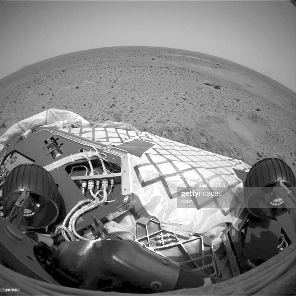 In this handout from NASA an image from the hazard avoidance camera on the Mars Exploration Rover Spirit shows the rover in a nearfinal turned...