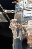 In this handout from NASA Astronaut John Grunsfeld performs work on the Hubble Space Telescope during the as the first of five STS125 spacewalks May...