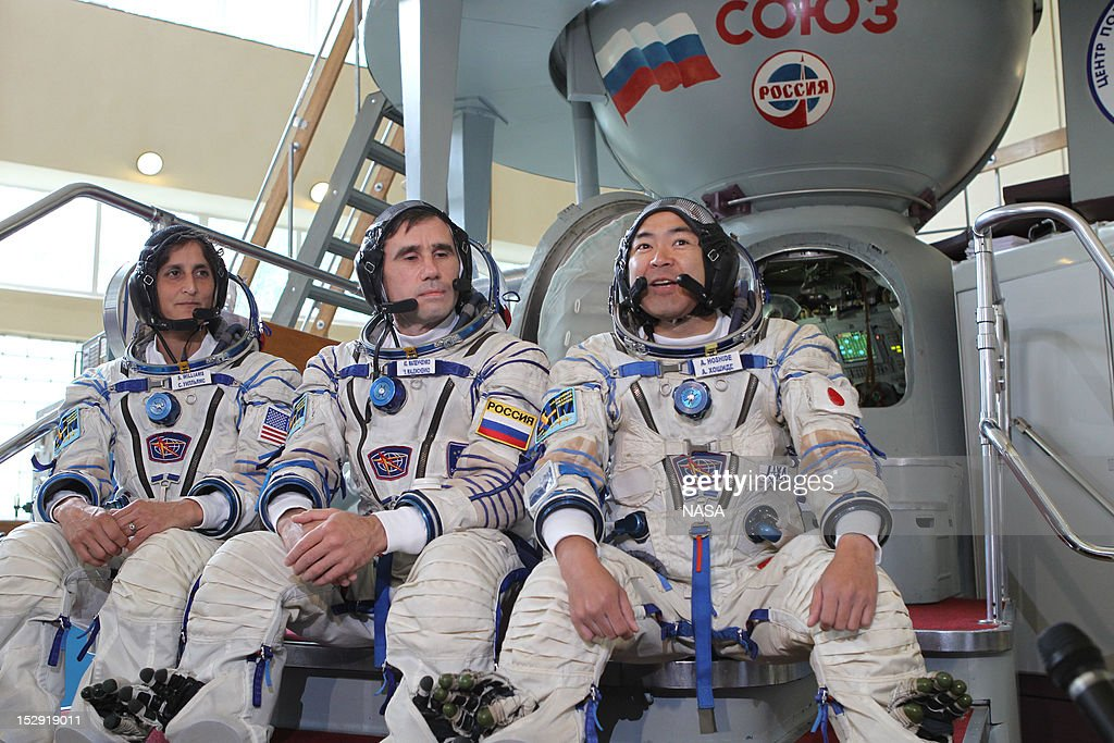 In this handout from NASA, (L to R) Expedition 32/33 NASA Flight Engineer <a gi-track='captionPersonalityLinkClicked' href=/galleries/search?phrase=Sunita+Williams&family=editorial&specificpeople=4001582 ng-click='$event.stopPropagation()'>Sunita Williams</a> of NASA, Soyuz Commander <a gi-track='captionPersonalityLinkClicked' href=/galleries/search?phrase=Yuri+Malenchenko&family=editorial&specificpeople=198749 ng-click='$event.stopPropagation()'>Yuri Malenchenko</a> and Japan Aerospace Exploration Agency Flight Engineer Aki Hoshide answer questions from the media at a Soyuz vehicle mock-up before their final qualification test June 20, 2012 at the Gagarin Cosmonaut Training Center in Star City, Russia.