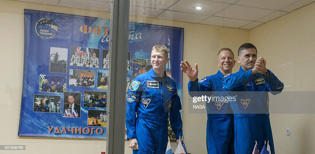 In this handout from NASA, (L to R) Expedition 46 Flight Engineer Tim Peake of the European Space Agency (ESA), Soyuz Commander Yuri Malenchenko of the Russian Federal Space Agency (Roscosmos) and Flight Engineer Tim Kopra of NASA leave after a press conference held at the Cosmonaut Hotel, on December 14, 2015 in Baikonur, Kazakhstan. Soyuz TMA-19M is scheduled to launch on December 15 carrying crew members Soyuz Commander Yuri Malenchenko of the Russian Federal Space Agency (Roscosmos), Flight Engineer Tim Kopra of NASA, and Flight Engineer Tim Peake of ESA (European Space Agency) to the International Space Station for a six-month mission, as part of Expedition 46-47.