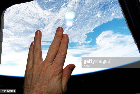 In this handout from NASA International Space Station astronaut Terry Virts make the Vulcan salute from 'Star Trek' and the character Spock who was...