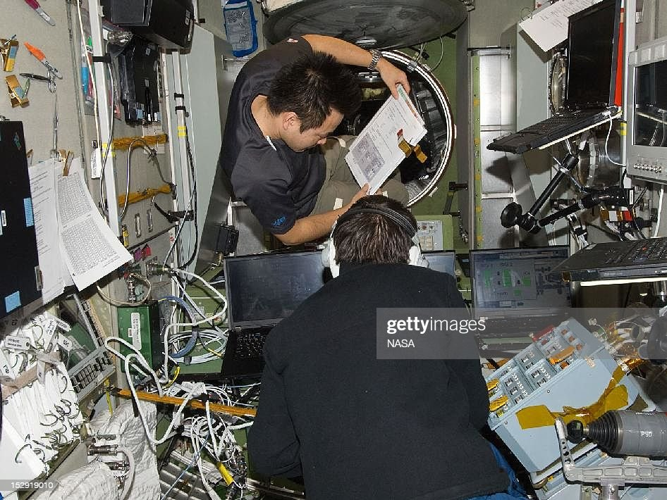 In this handout from NASA, Japan Aerospace Exploration Agency astronaut Aki Hoshide (L) and Russian cosmonaut <a gi-track='captionPersonalityLinkClicked' href=/galleries/search?phrase=Yuri+Malenchenko&family=editorial&specificpeople=198749 ng-click='$event.stopPropagation()'>Yuri Malenchenko</a>, both Expedition 33 flight engineers, work in the Zvezda Service Module of the International Space Station September 25, 2012 in Space.