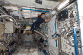 In this handout from NASA Japan Aerospace Exploration Agency astronaut Aki Hoshide Expedition 32 flight engineer uses a vacuum cleaner during...