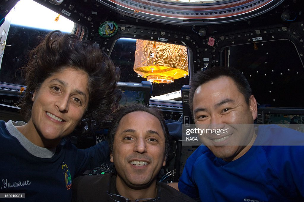 In this handout from NASA, (L to R) NASA astronauts <a gi-track='captionPersonalityLinkClicked' href=/galleries/search?phrase=Sunita+Williams&family=editorial&specificpeople=4001582 ng-click='$event.stopPropagation()'>Sunita Williams</a> and Joe Acaba and Japan Aerospace Exploration Agency astronaut Aki Hoshide, all Expedition 32 flight engineers, pose in the International Space Station's Cupola following the rendezvous with the unpiloted Japan Aerospace Exploration Agency (JAXA) H-II Transfer Vehicle (HTV-3) July 27, 2012 in Space.