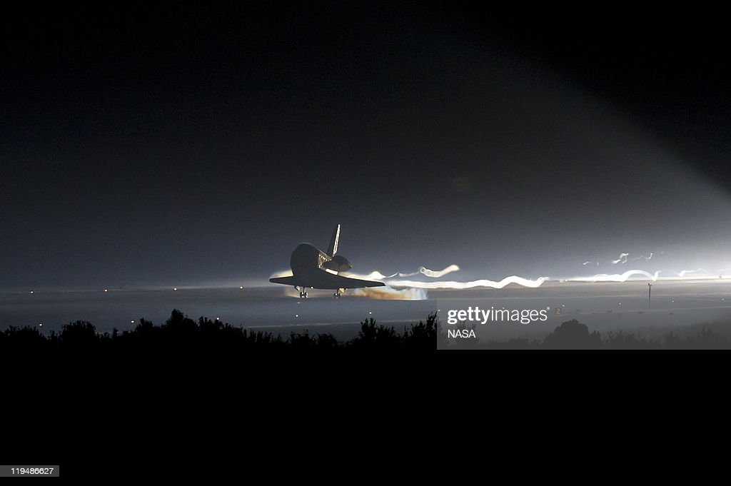 In this handout from NASA Space Shuttle Atlantis lands at the Kennedy Space Center July 21 2011 in Cape Canaveral Florida The landing brings to a...