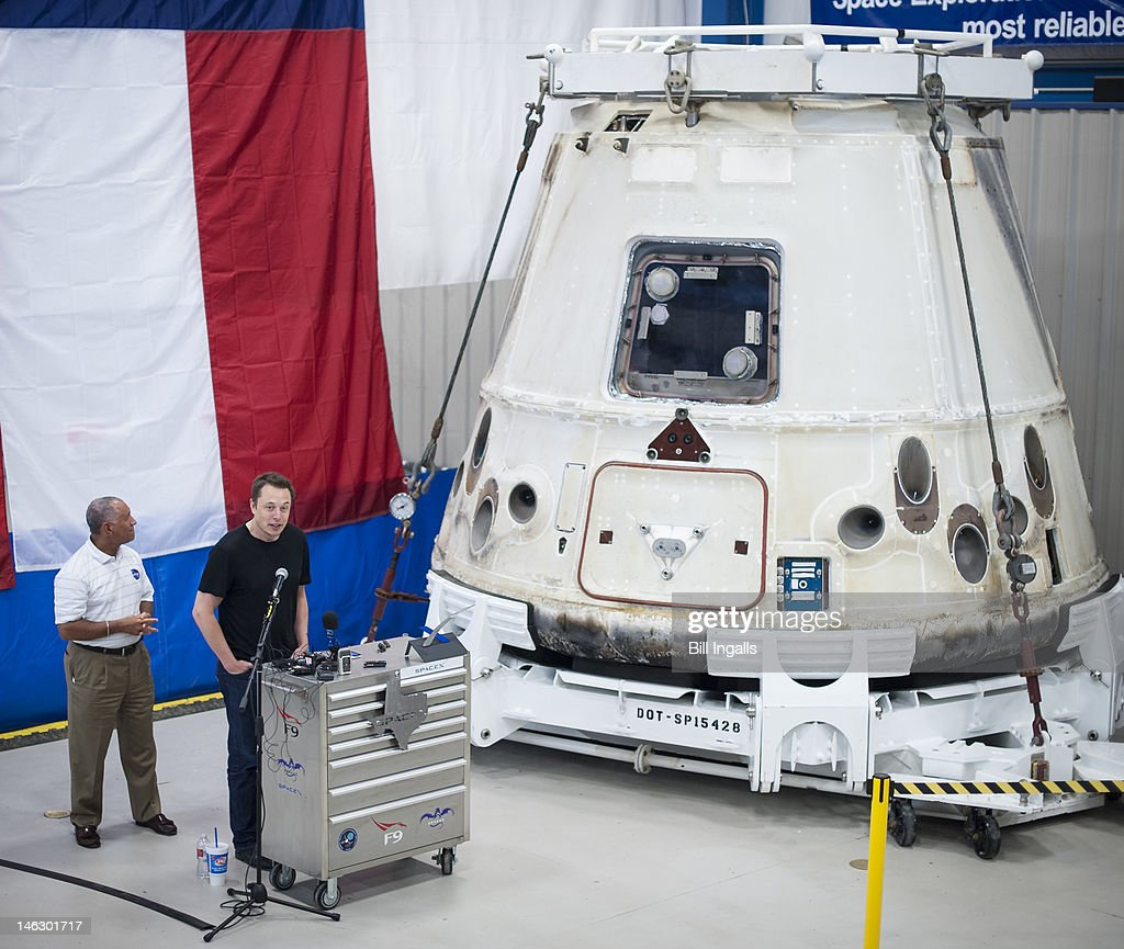 In this handout from NASA SpaceX CEO and Chief Designer Elon Musk speaks as NASA Administrator Charles Bolden listens next to the Dragon capsule at...