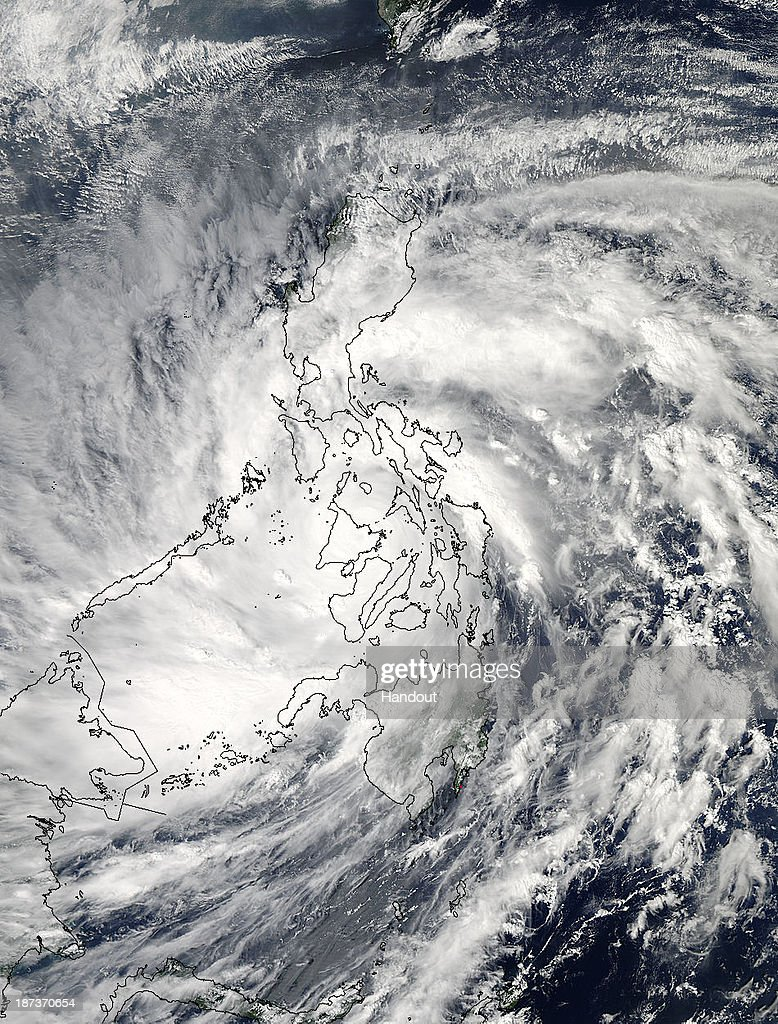 In this handout from NASA, Super Typhoon Haiyan moves over the central Philippines on November 8, 2013 from space. Haiyan, being called one of the strongest storms on record, slammed into the Philippines November 8, with gusts up to 170 mile per hour (275 kilometers per hour) and sustained winds of 147 miles per hour