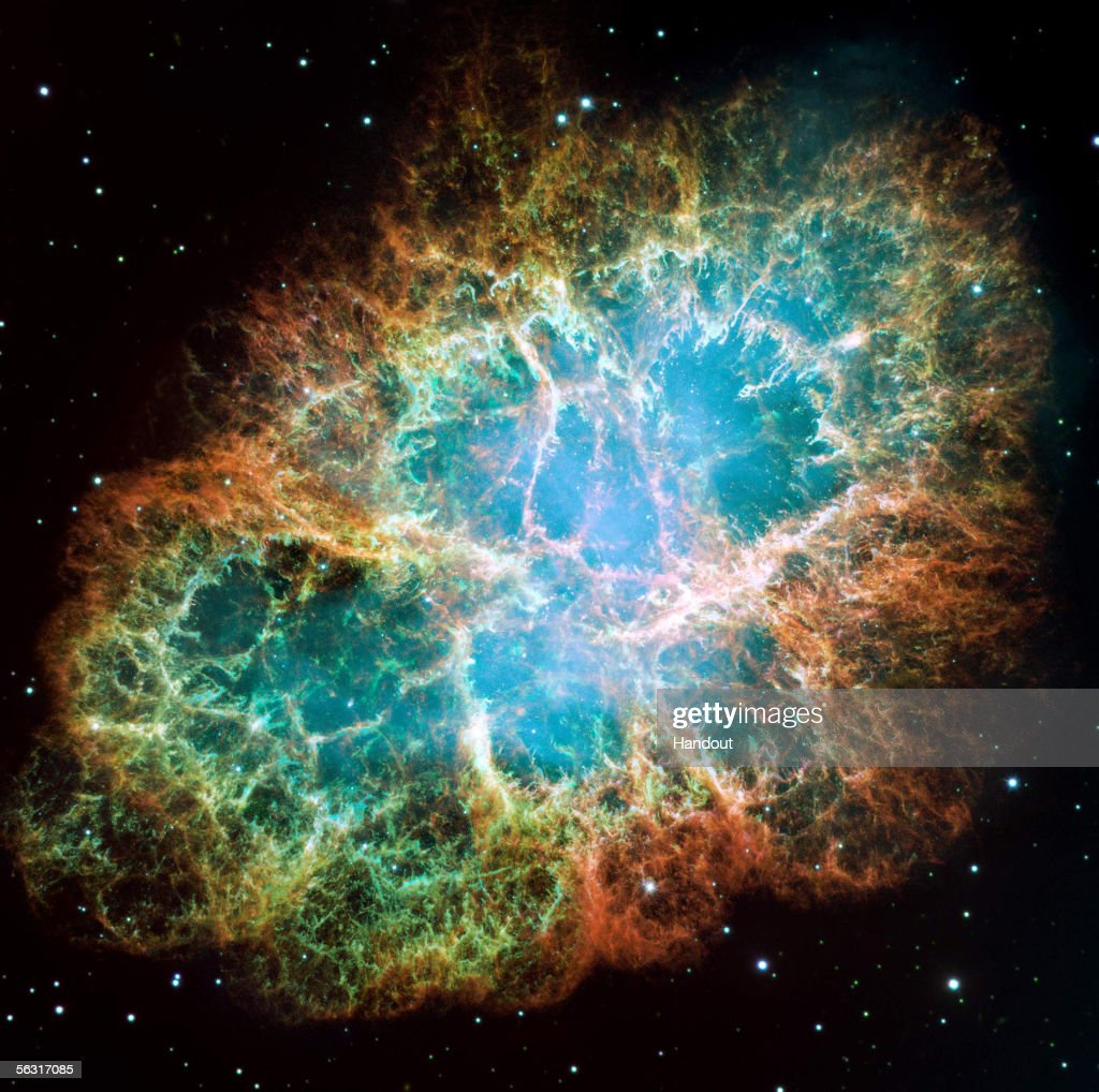 In this handout from NASA, the mosaic image, one of the largest ever taken by NASA's Hubble Space Telescope of the Crab Nebula, shows six-light-year-wide expanding remnant of a star's supernova explosion as released December 2, 2005. Japanese and Chinese astronomers witnessed this violent event nearly 1,000 years ago in 1054, together with, possibly, Native Americans. The orange filaments are the remains of the star and consist mostly of hydrogen. The rapidly spinning neutron star embedded in the center of the nebula is the dynamo powering the nebula's eerie interior bluish glow. The blue light comes from electrons whirling at nearly the speed of light around magnetic field lines from the neutron star. The neutron star, the crushed ultra-dense core of the exploded star, ejects twin beams of radiation that appear to pulse 30 times a second due to the neutron star's rotation.