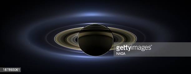 In this handout from NASA the planet Saturn is seen backlit by the sun sent Cassini spacecraft July 19 2013 in space NASA unvieled the image that...