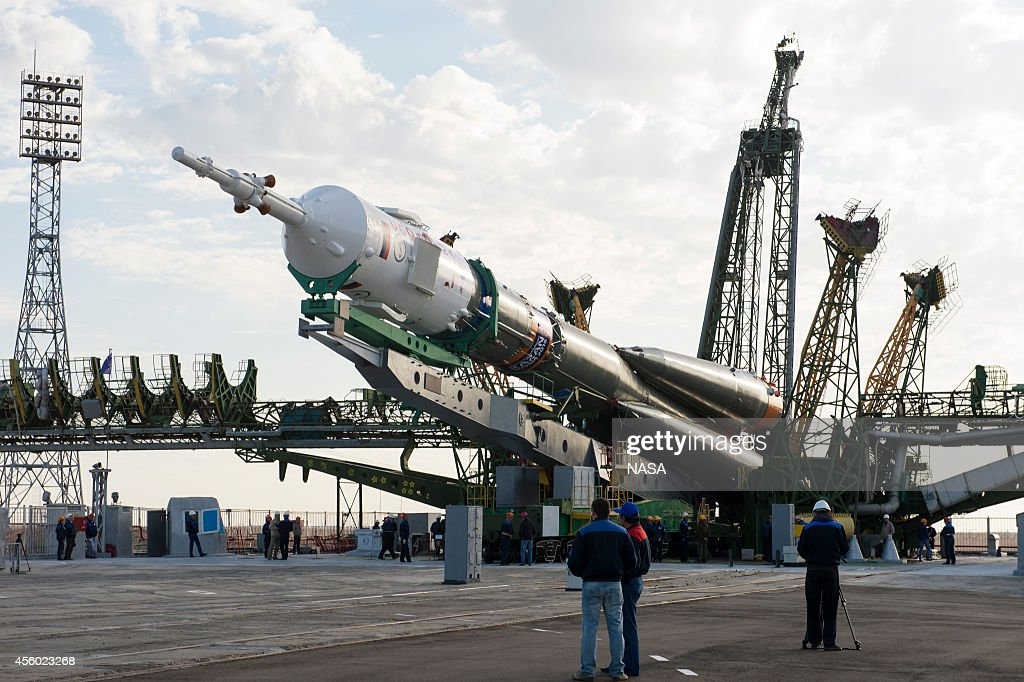 In this handout from NASA the Soyuz TMA14M spacecraft is raised into position September 23 2014 at the Baikonur Cosmodrome in Kazakhstan The launch...